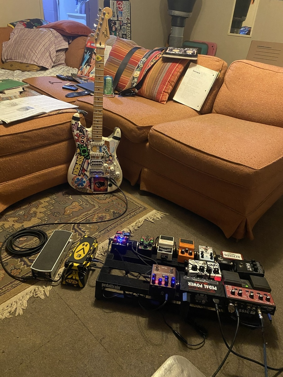 Photo of Ernie Ball VP JR. Passive Volume Pedal and more gear in a pedalboard and guitar