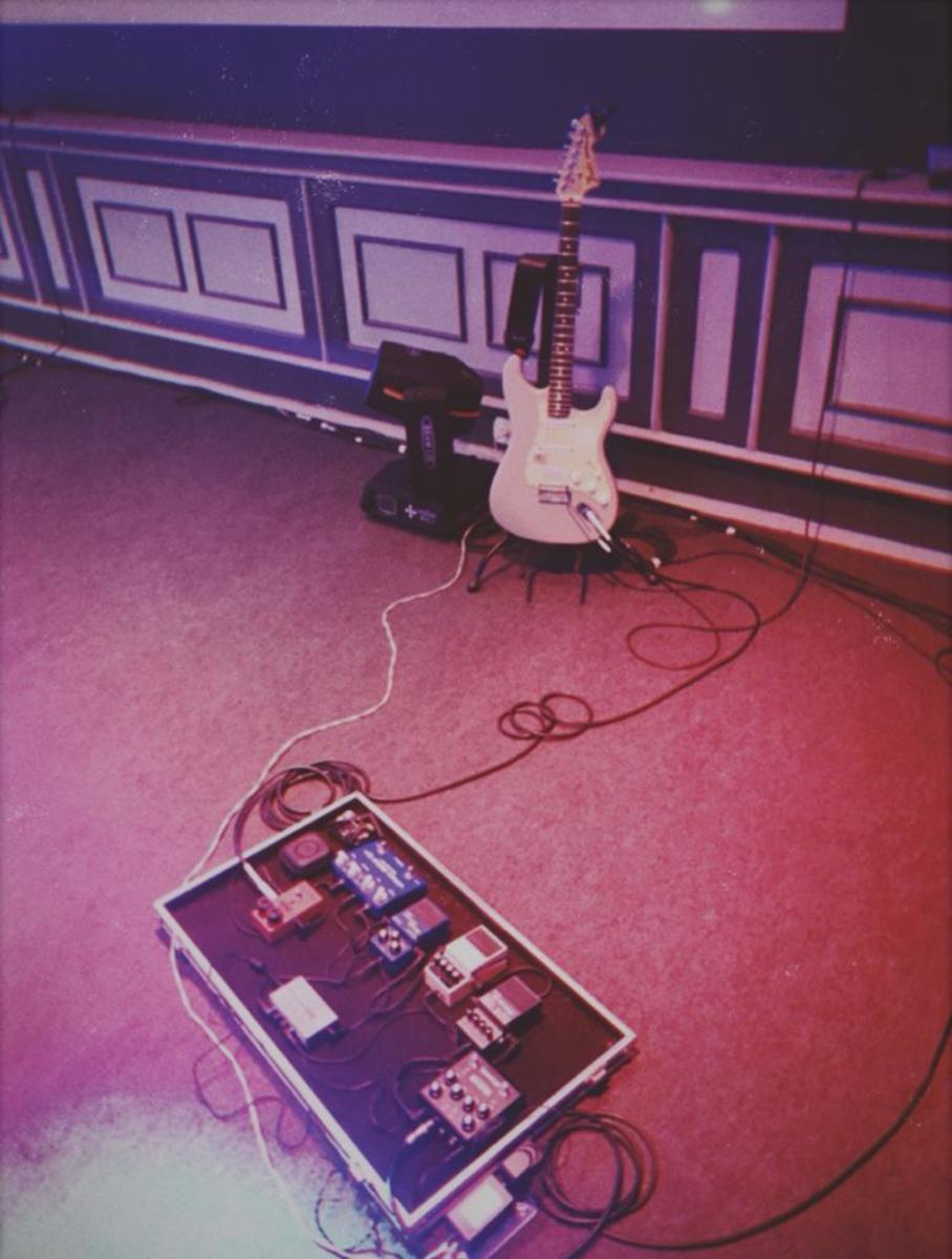 Photo of Strymon Iridium Amp & IR Cab and more gear in a pedalboard, guitar, and live
