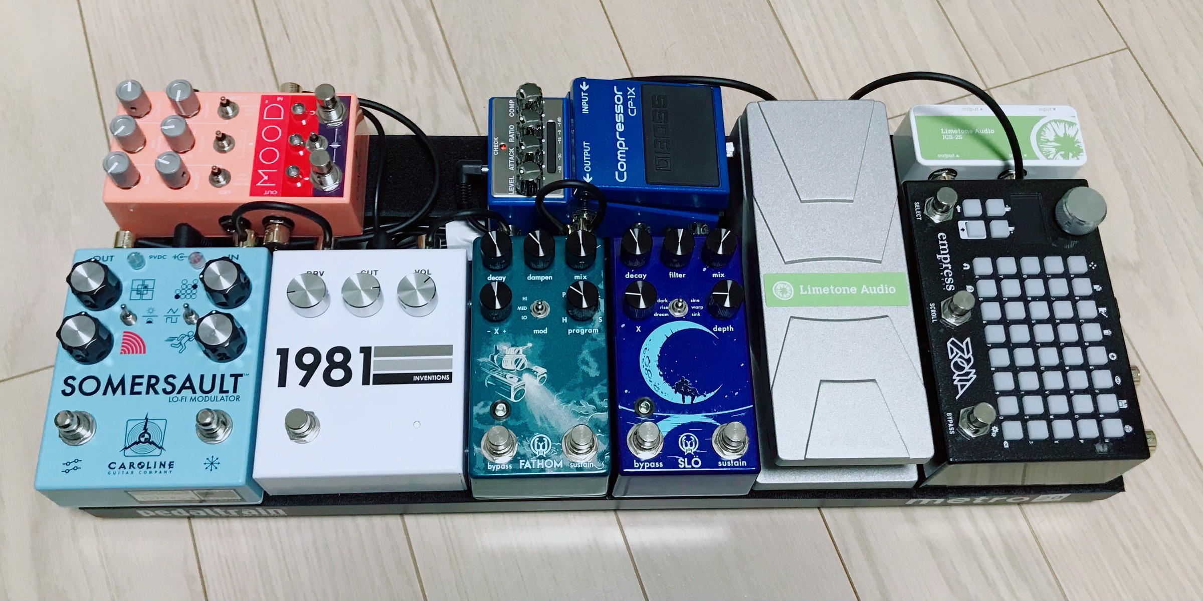 Photo of Walrus Audio Slö and more gear in a pedalboard and guitar