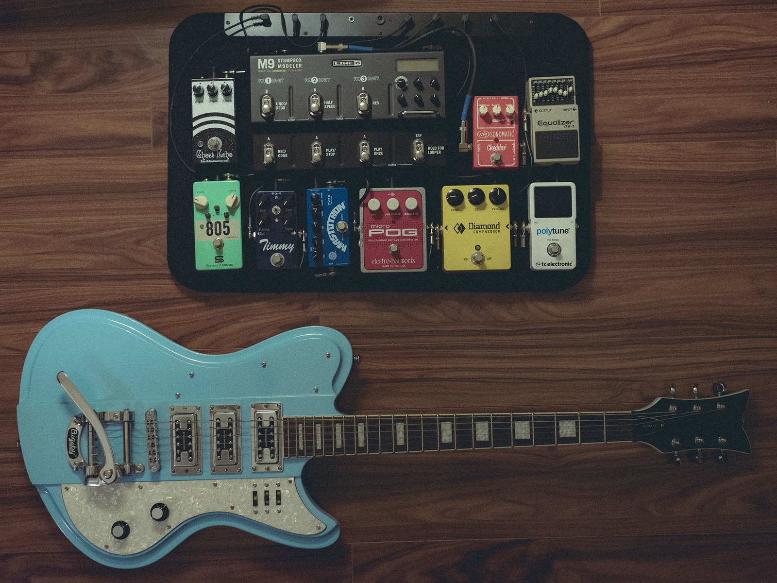 Photo of Paul Cochrane Timmy Transparent Overdrive and more gear in a pedalboard, guitar, and signal chain