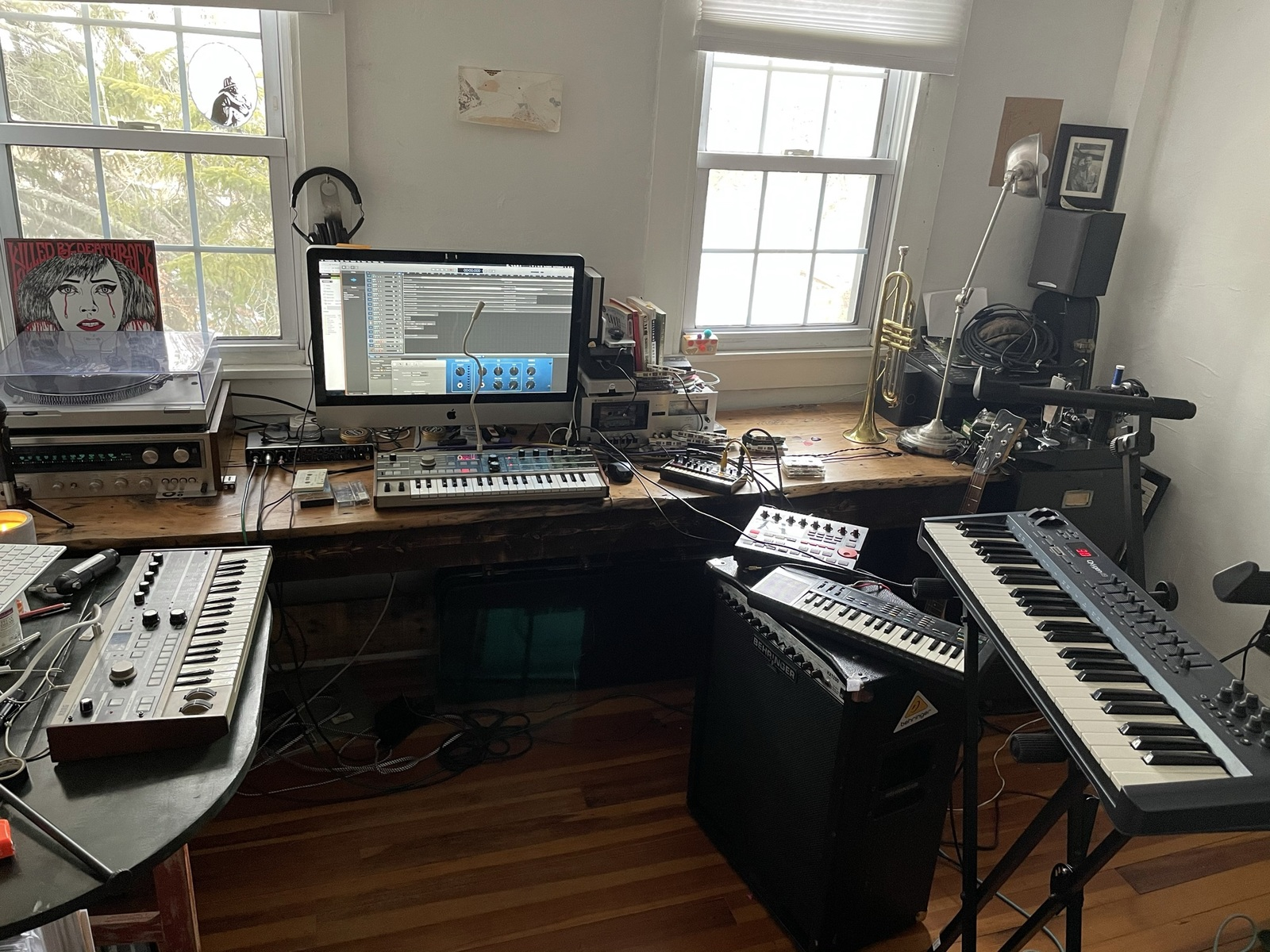 Photo of Casio SK-1 and more gear in a studio, Bass, and synths