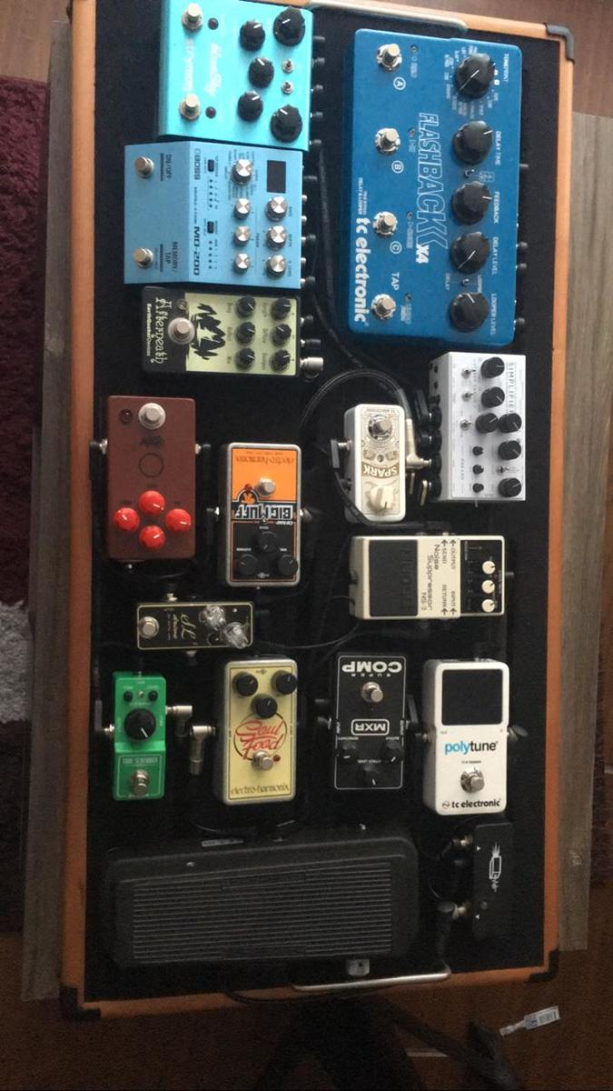 Photo of TC Electronic Polytune 2 and more gear in a pedalboard, guitar, and live