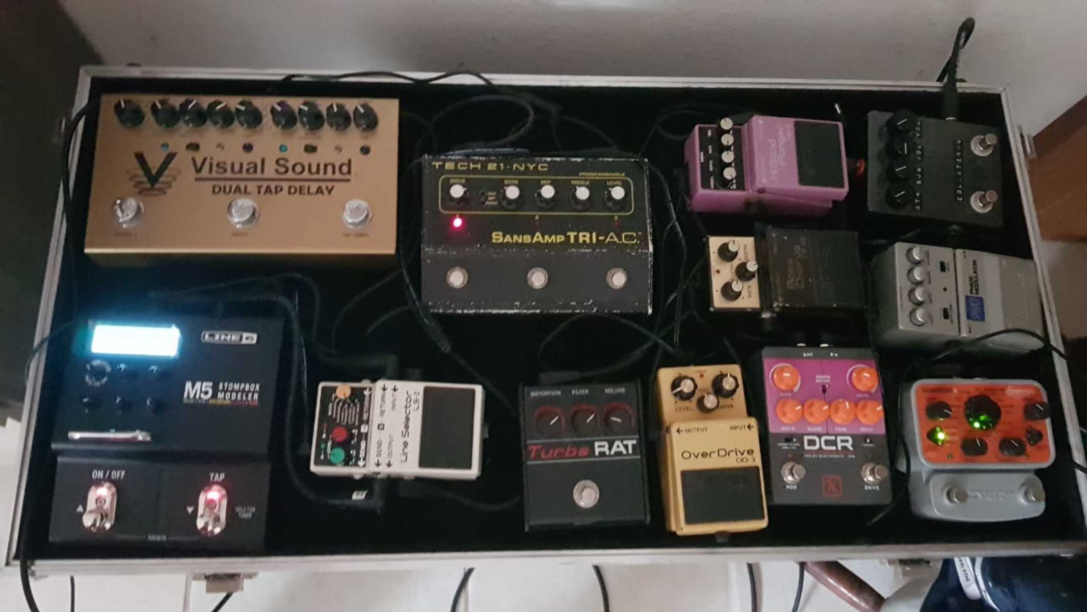 Photo of Boss LS-2 Line Selector and more gear in a pedalboard, guitar, and signal chain