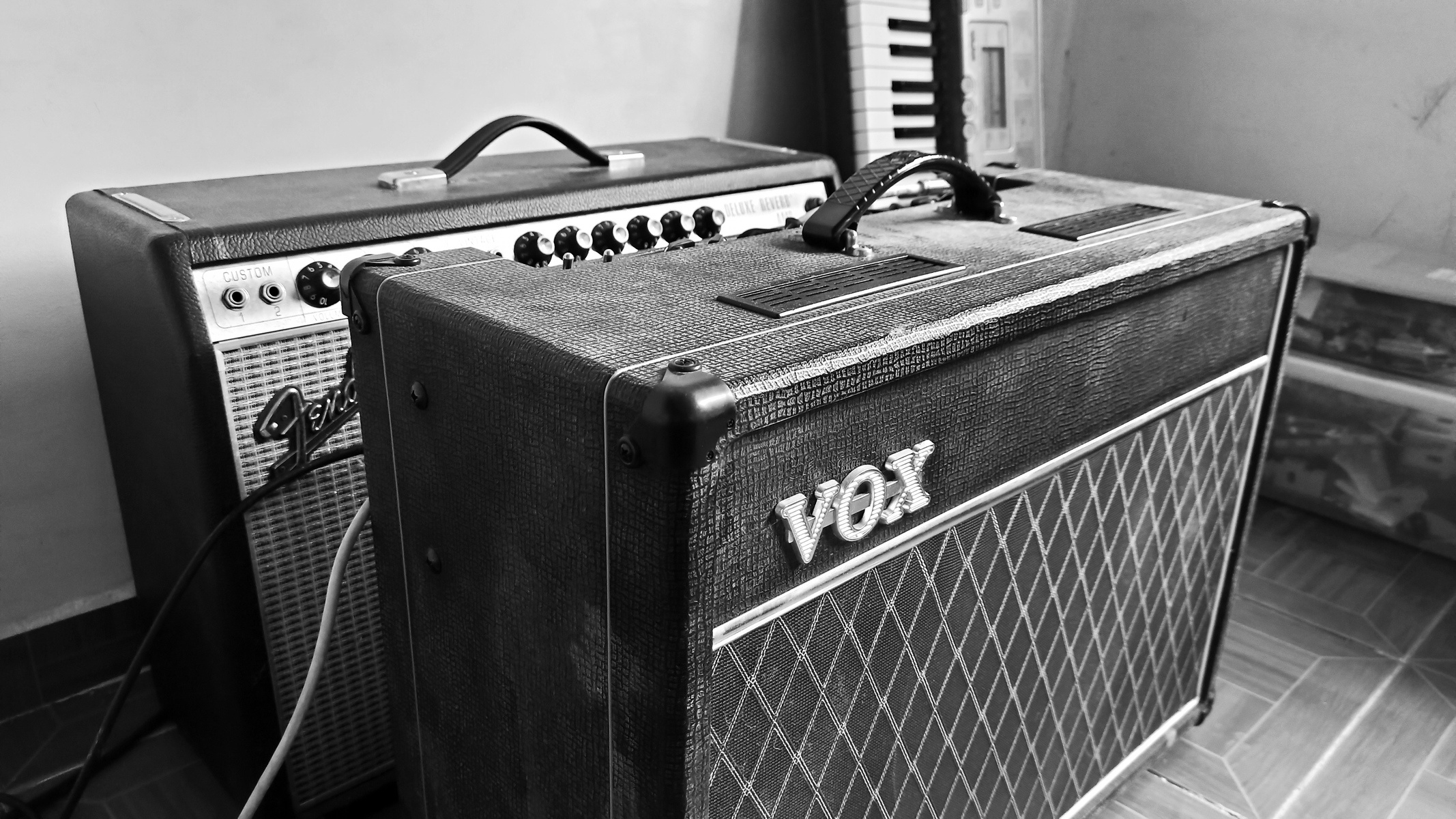 Photo of Fender '68 Custom Deluxe Reverb Guitar Amplifier and more gear in a studio and guitar