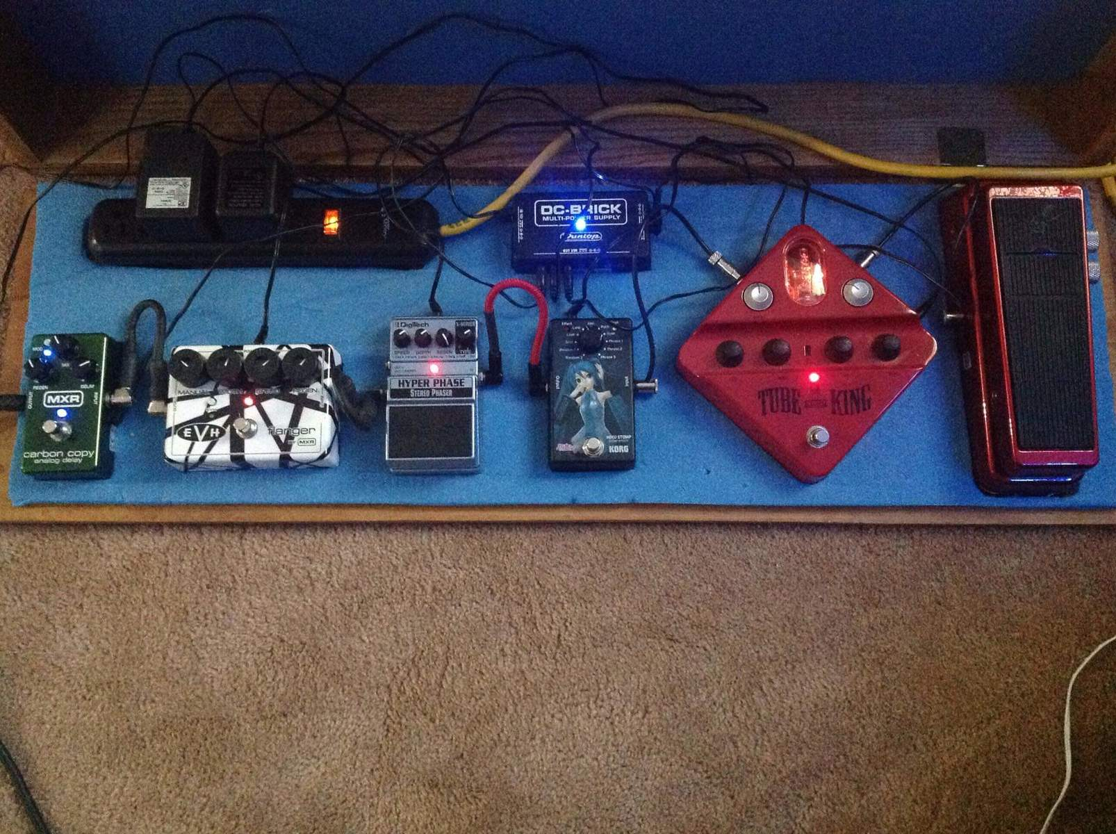 Photo of Dunlop SW95 Slash Signature Cry Baby Wah Wah and more gear in a pedalboard, guitar, and signal chain