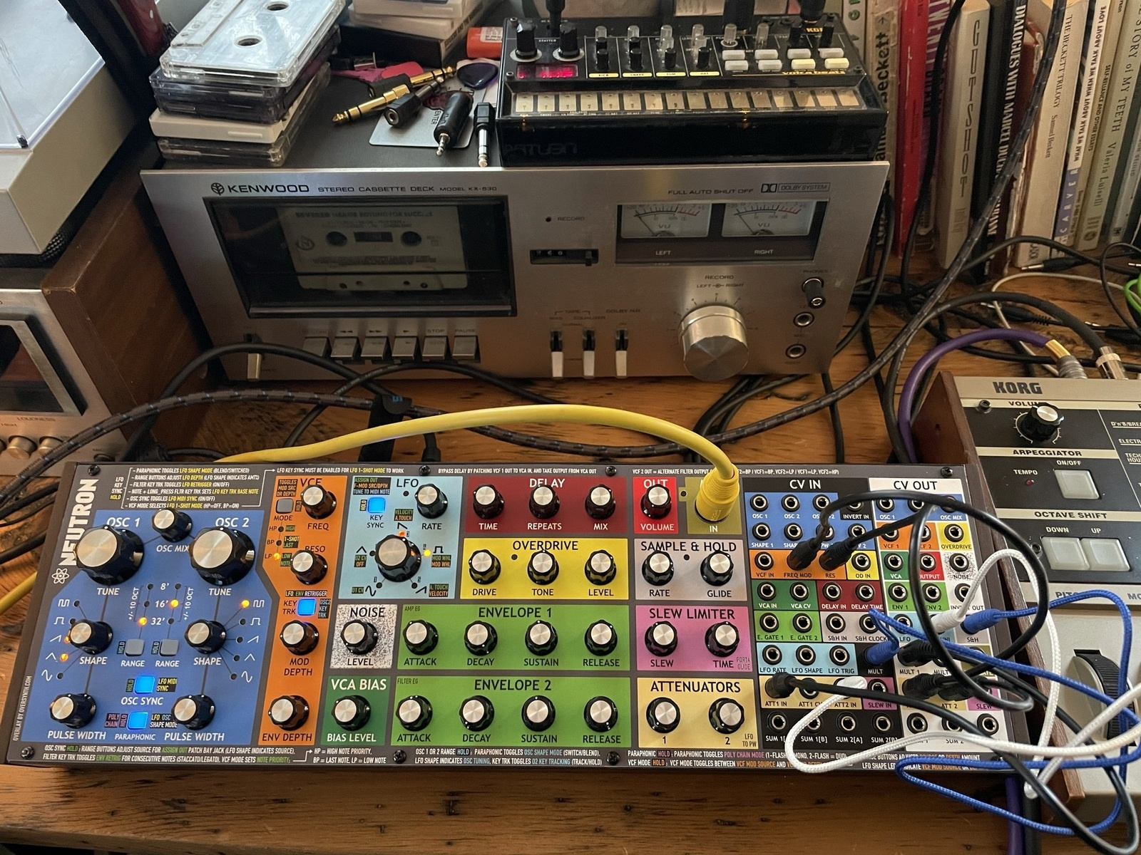 Photo of Korg MicroKORG Synthesizer/Vocoder and more gear in a closeup and synths