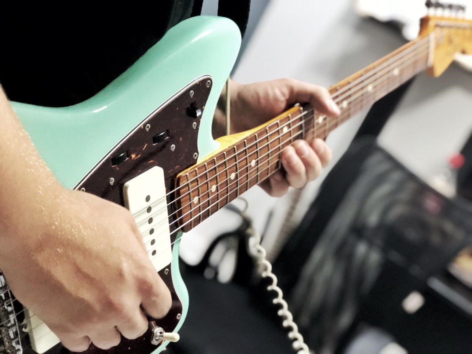 Photo of Fender Jazzmaster Electric Guitar in a studio, guitar, and closeup