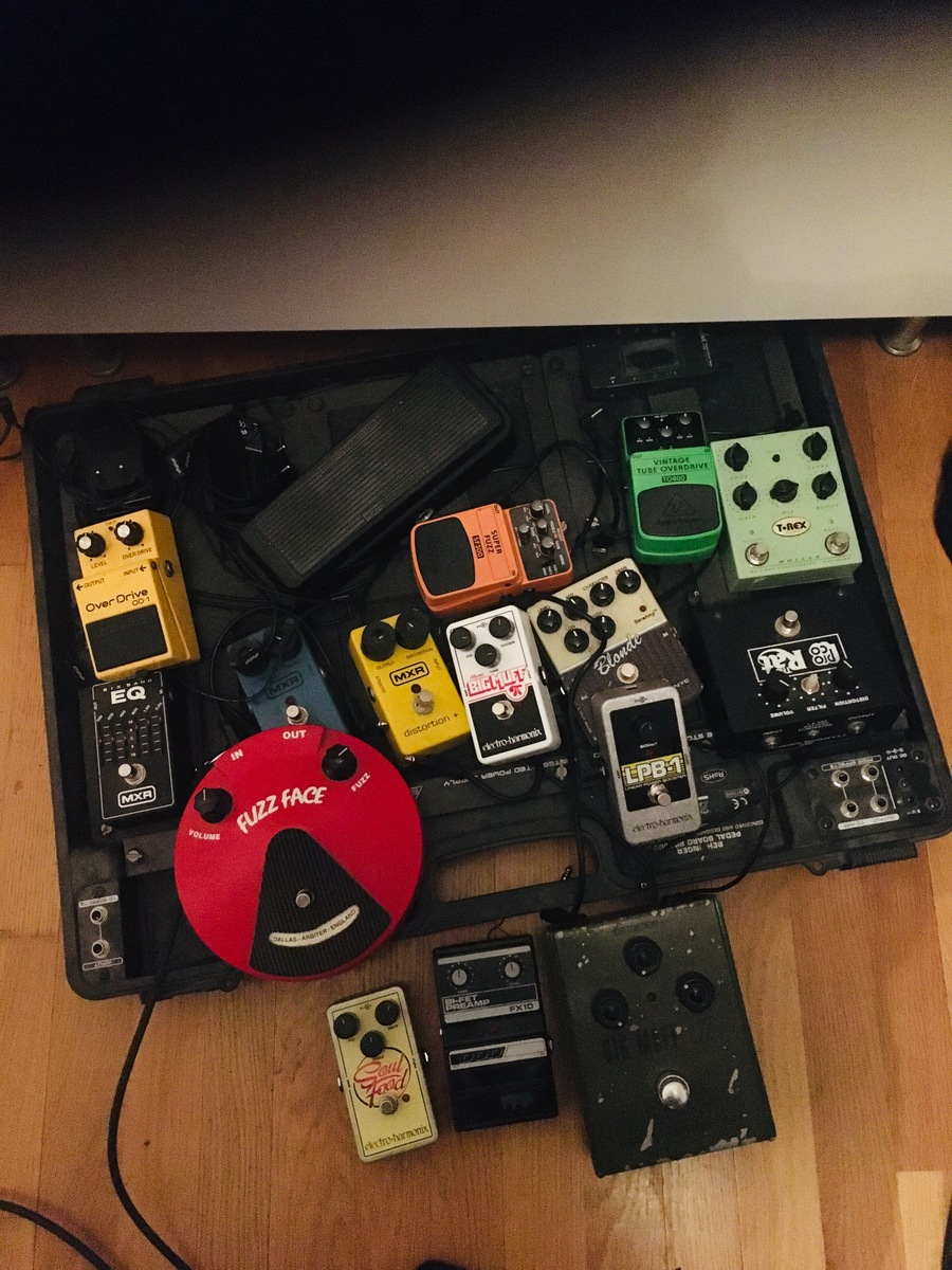 Photo of Pro Co The Rat and more gear in a pedalboard