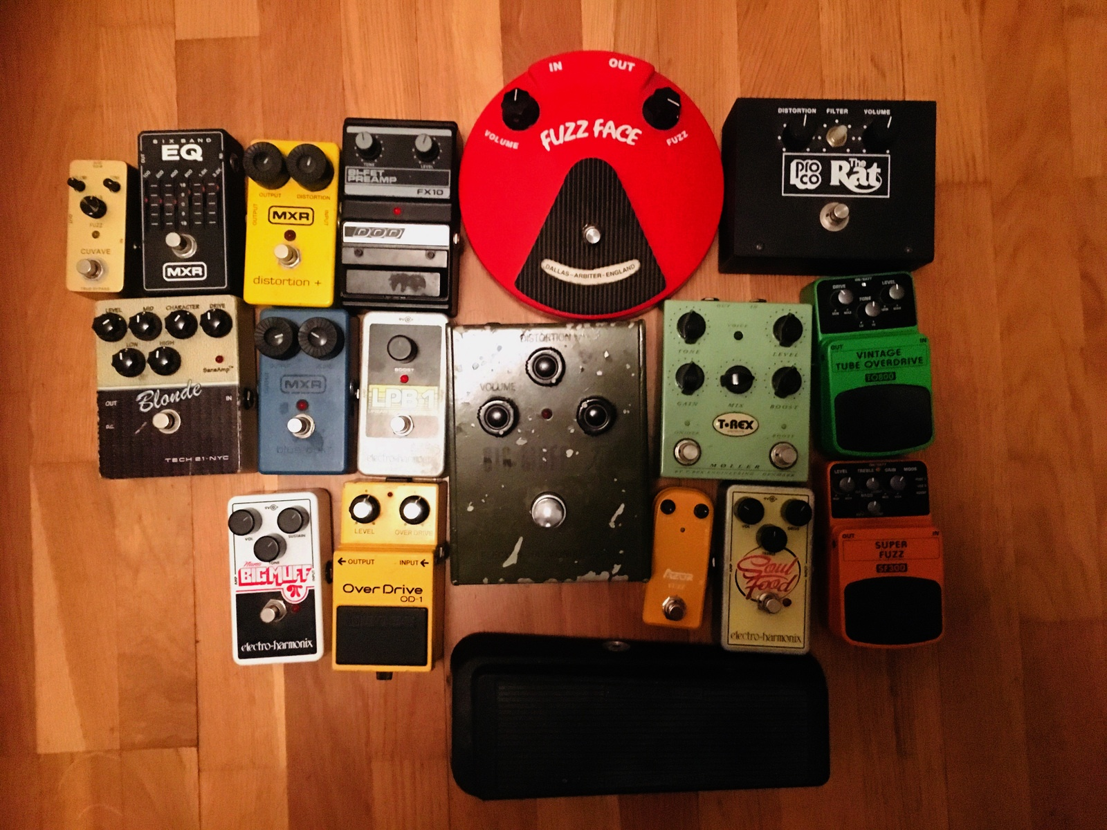 Photo of Pro Co The Rat and more gear in a pedalboard, studio, and guitar