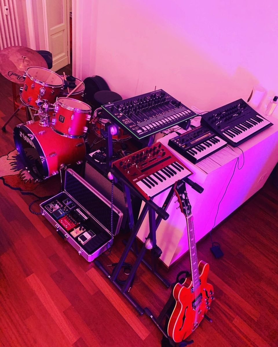 Photo of Korg Minilogue XD and more gear in a pedalboard, guitar, and synths