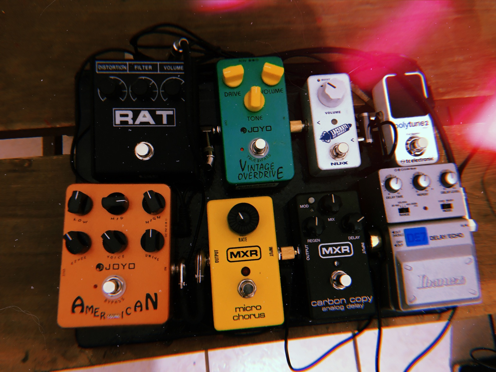Photo of Ibanez Tone-Lok DE7 Stereo Delay/Echo and more gear in a pedalboard and studio