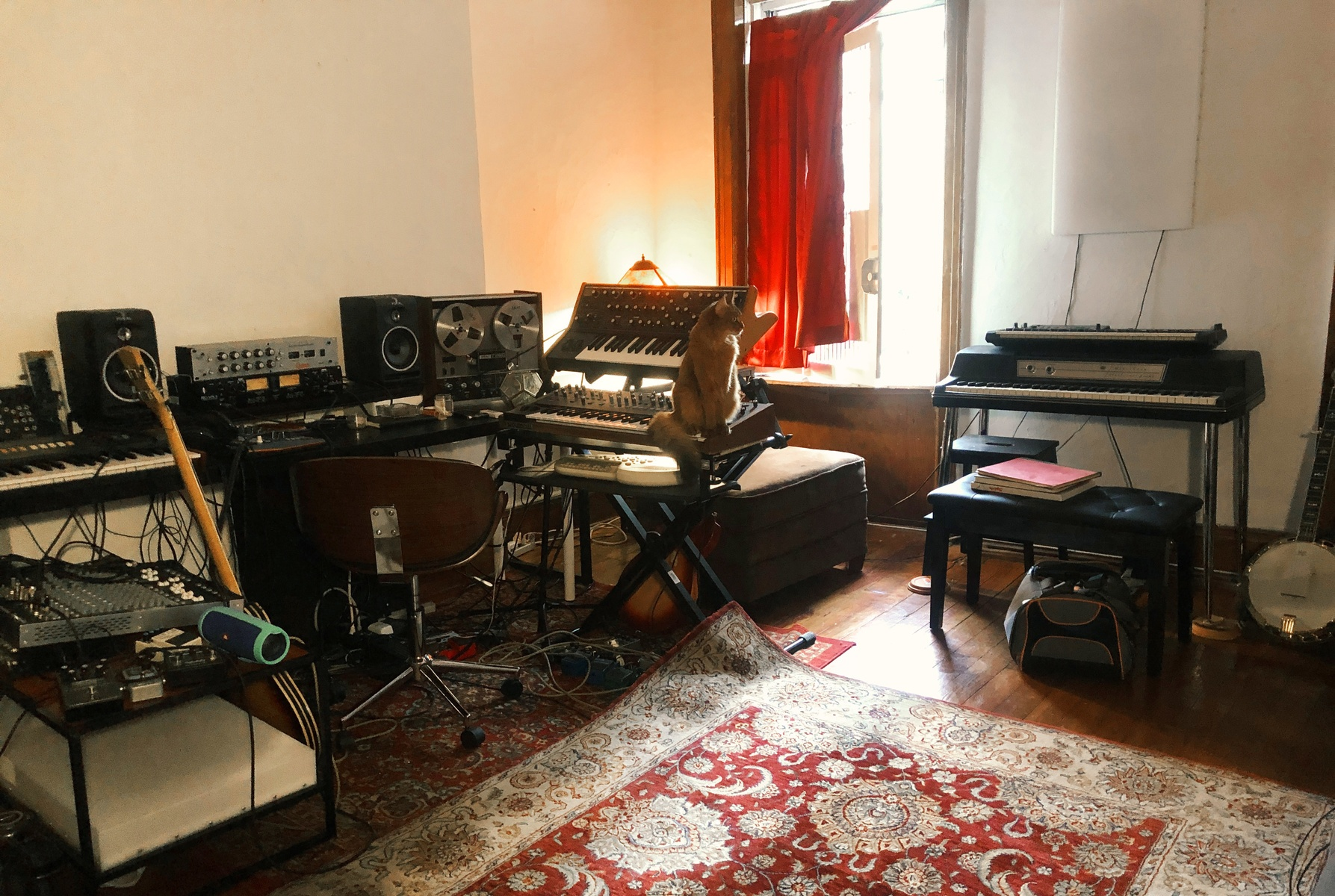 Photo of Wurlitzer 200A and more gear in a studio, guitar, and synths