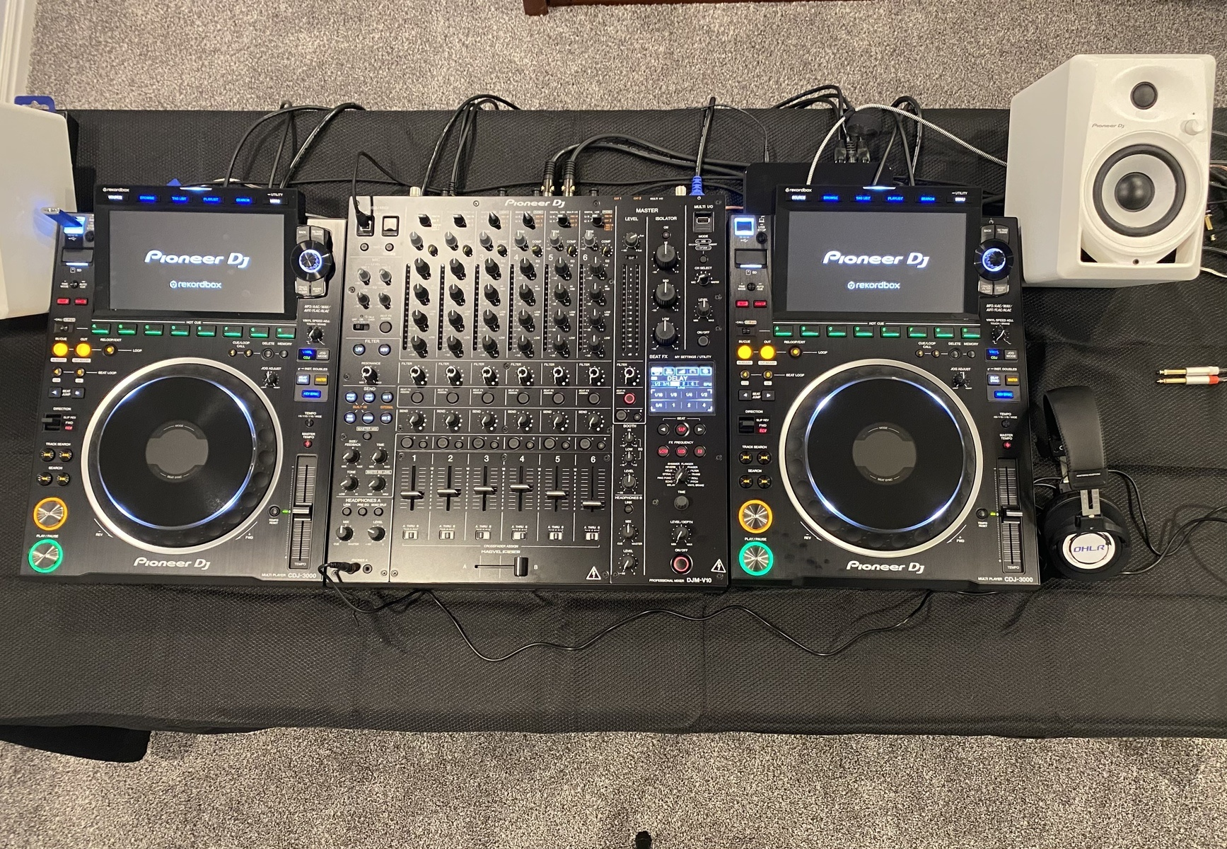 Photo of Pioneer DJ DJM-V10 and more gear in a DJ