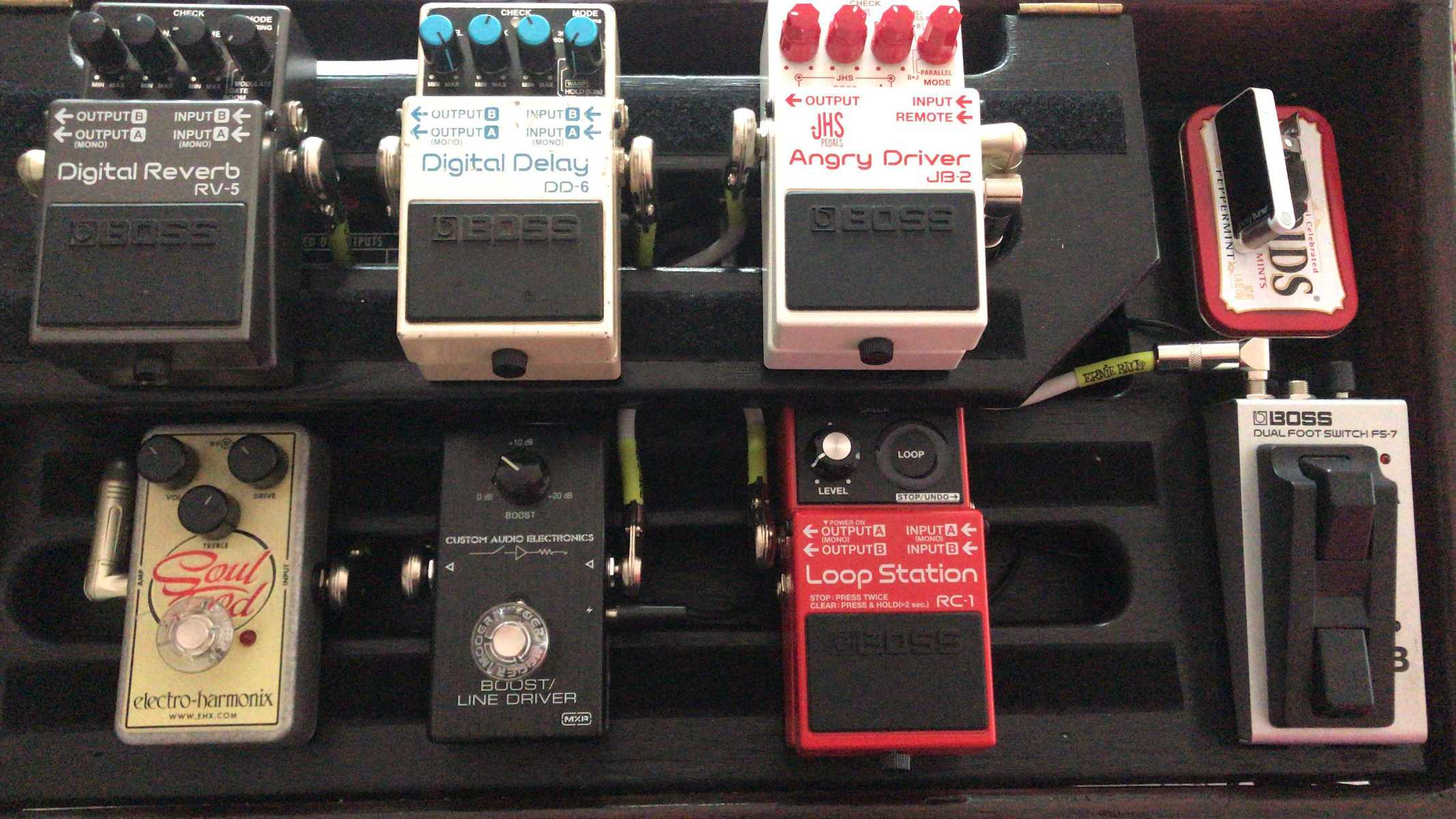 Photo of Boss DD-6 Digital Delay and more gear in a pedalboard