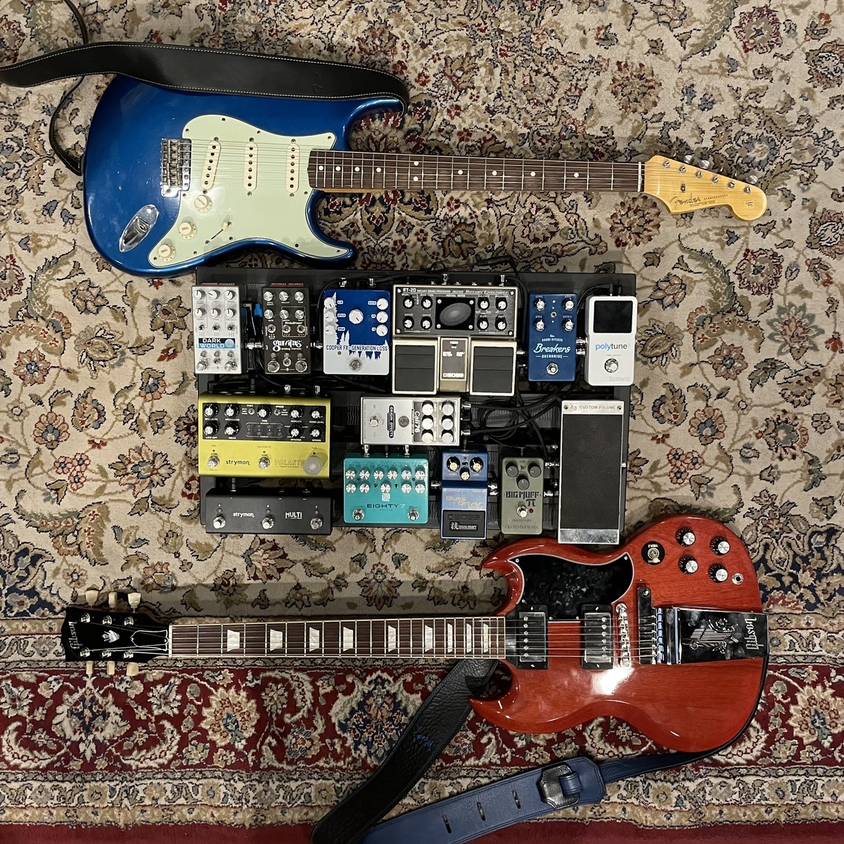 Photo of Origin Effects Cali76 Compact Deluxe and more gear in a pedalboard, studio, and guitar