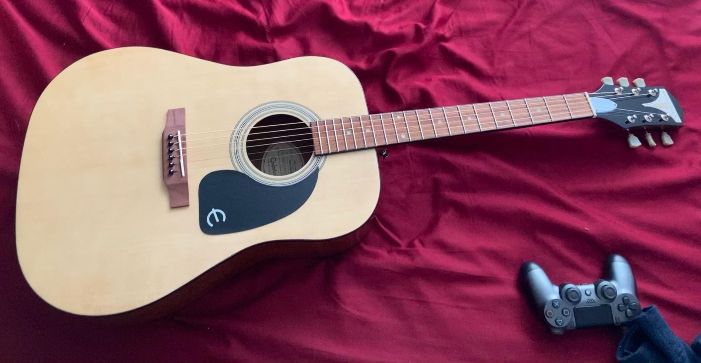 heartbreak1's guitar photo containing Epiphone PRO - 1 Acoustic