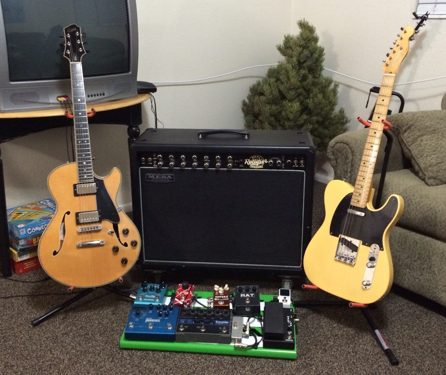 Photo of Eventide TimeFactor Twin Delay and more gear in a pedalboard, guitar, and amplifier