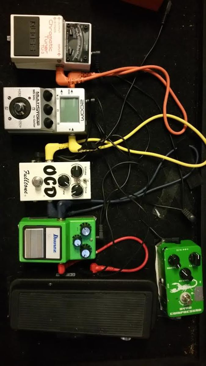 Photo of Boss TU-3 Chromatic Tuner and more gear in a pedalboard