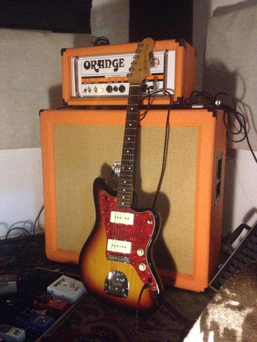 Photo of Orange Amplifiers TH30H 30W Tube Guitar Amp Head in a guitar and amplifier