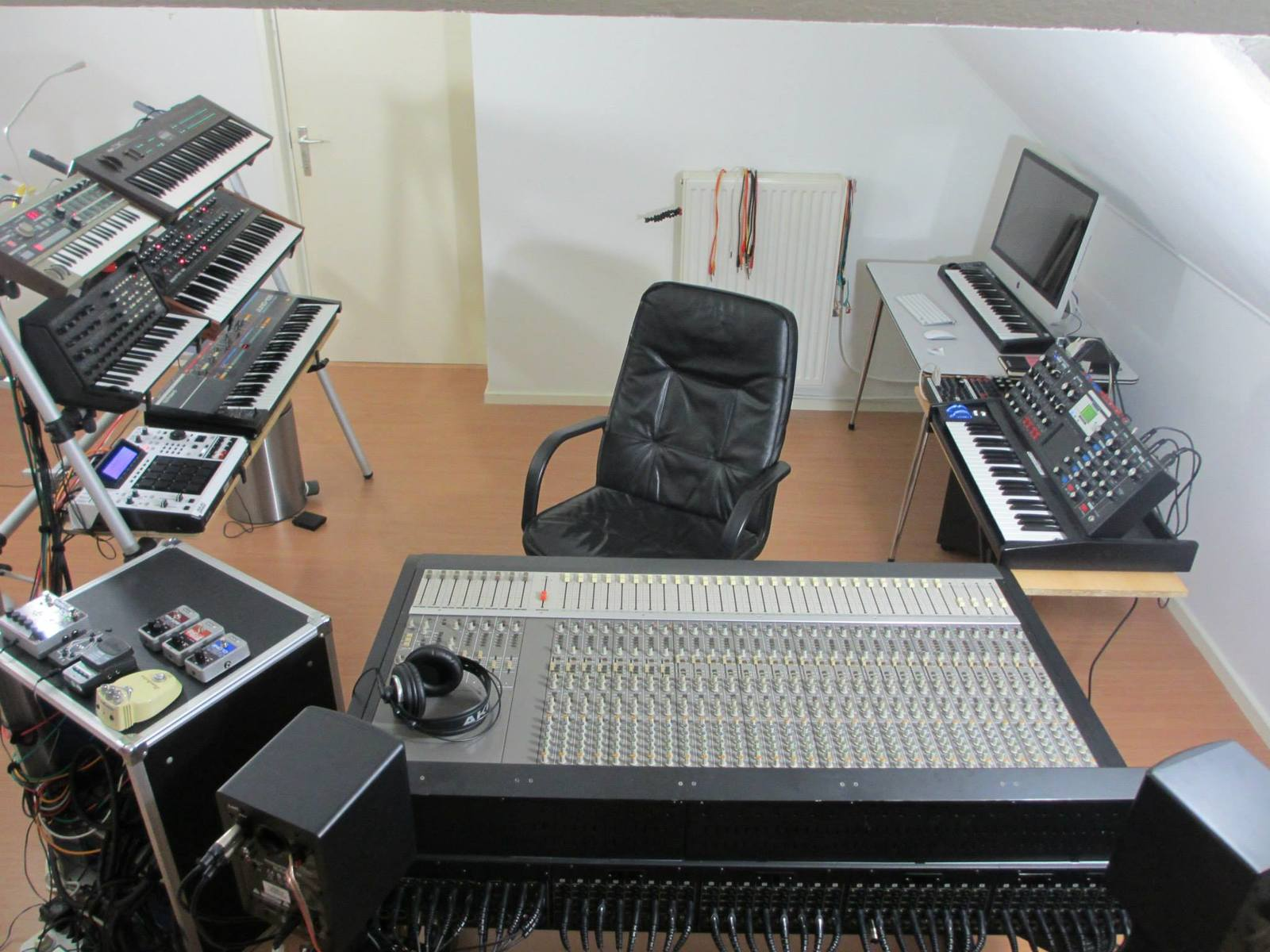Photo of Korg MicroKORG Synthesizer/Vocoder and more gear in a studio and synths