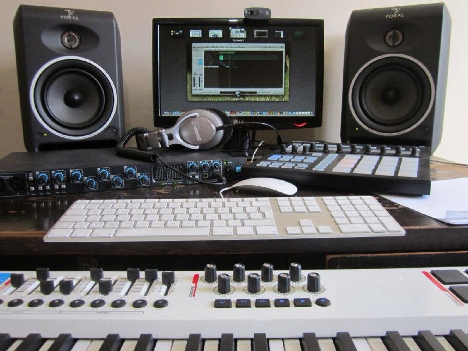 Photo of M-Audio Axiom Pro 61 Advanced 61 Key USB MIDI Controller and more gear in a studio