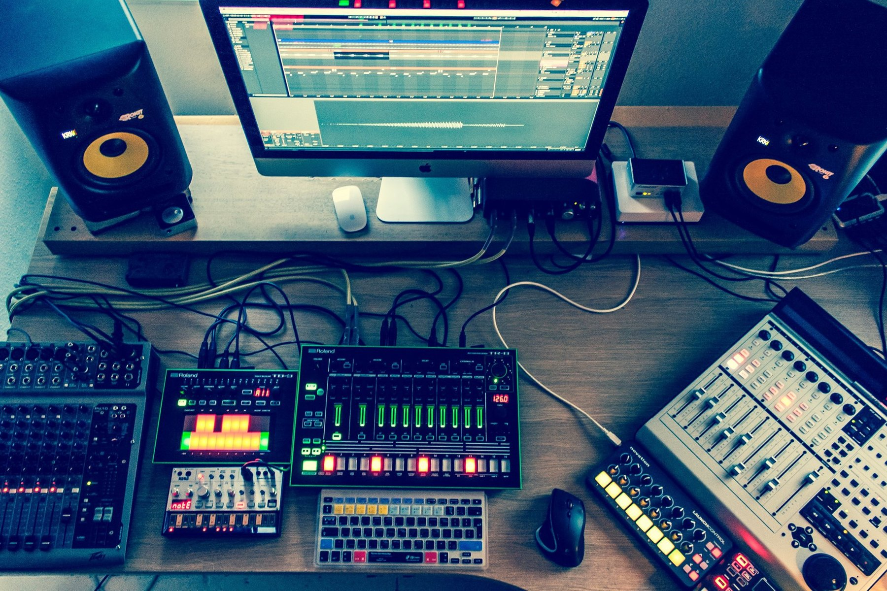 Photo of Roland AIRA TR-8 and more gear in a studio