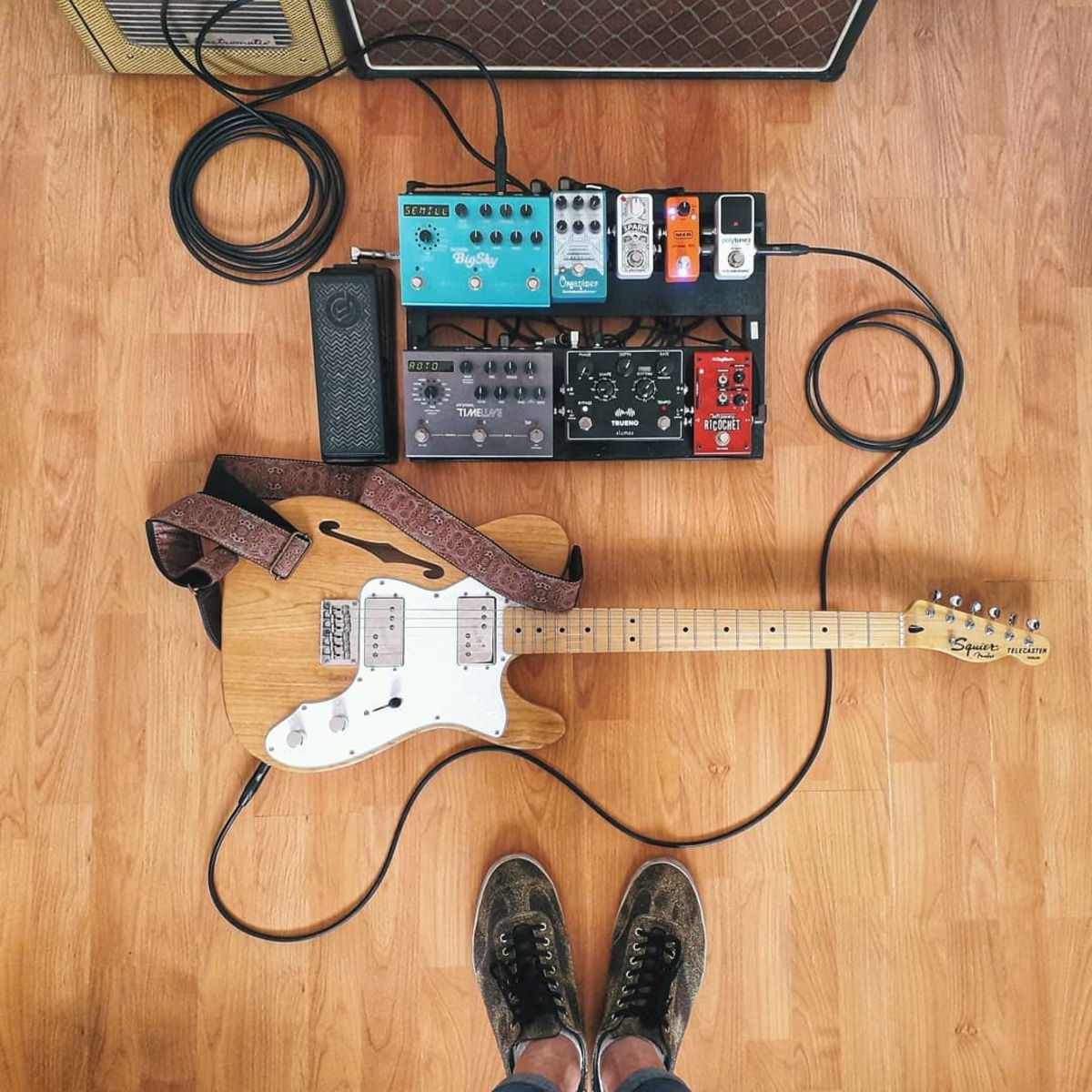 Photo of TC Electronic Spark Mini Booster and more gear in a pedalboard, guitar, and amplifier