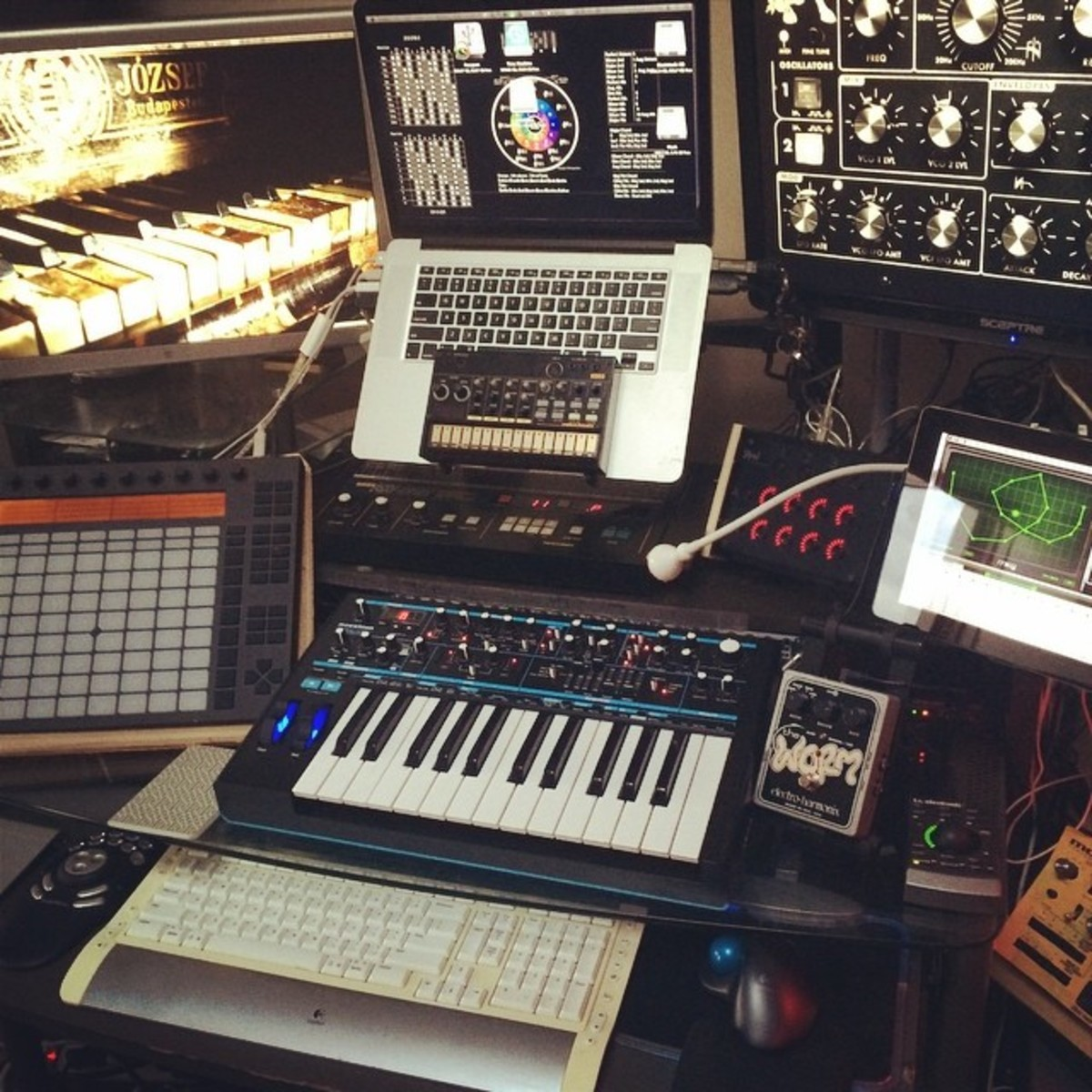 Photo of Novation Bass Station II Analogue Mono-Synth and more gear in a studio and synths