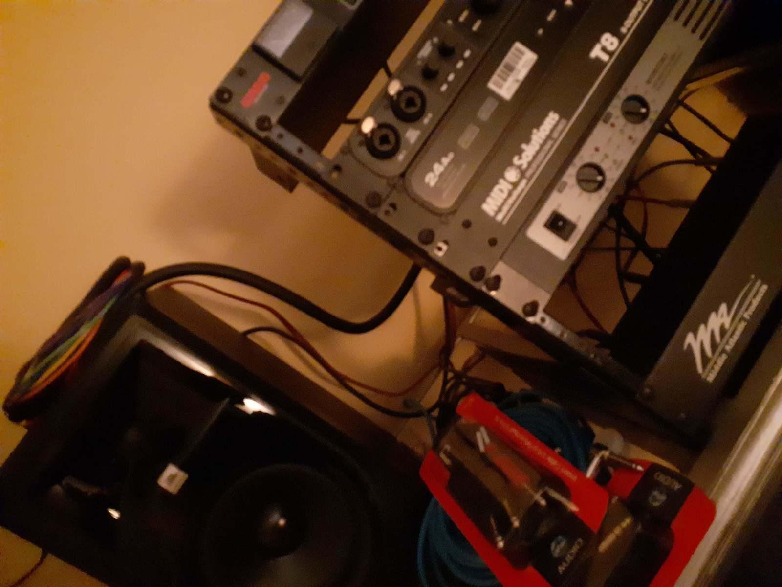 "jimmarchi1's studio photo containing MIDI Solutions T8 8-output MIDI Thru Box, MOTU 24Ao USB/AVB Ethernet Audio Interface, MOTU 828es, JBL 306P MKII Powered 6.5"" Two-Way Studio Monitors, and Warm Audio Bus-Comp"