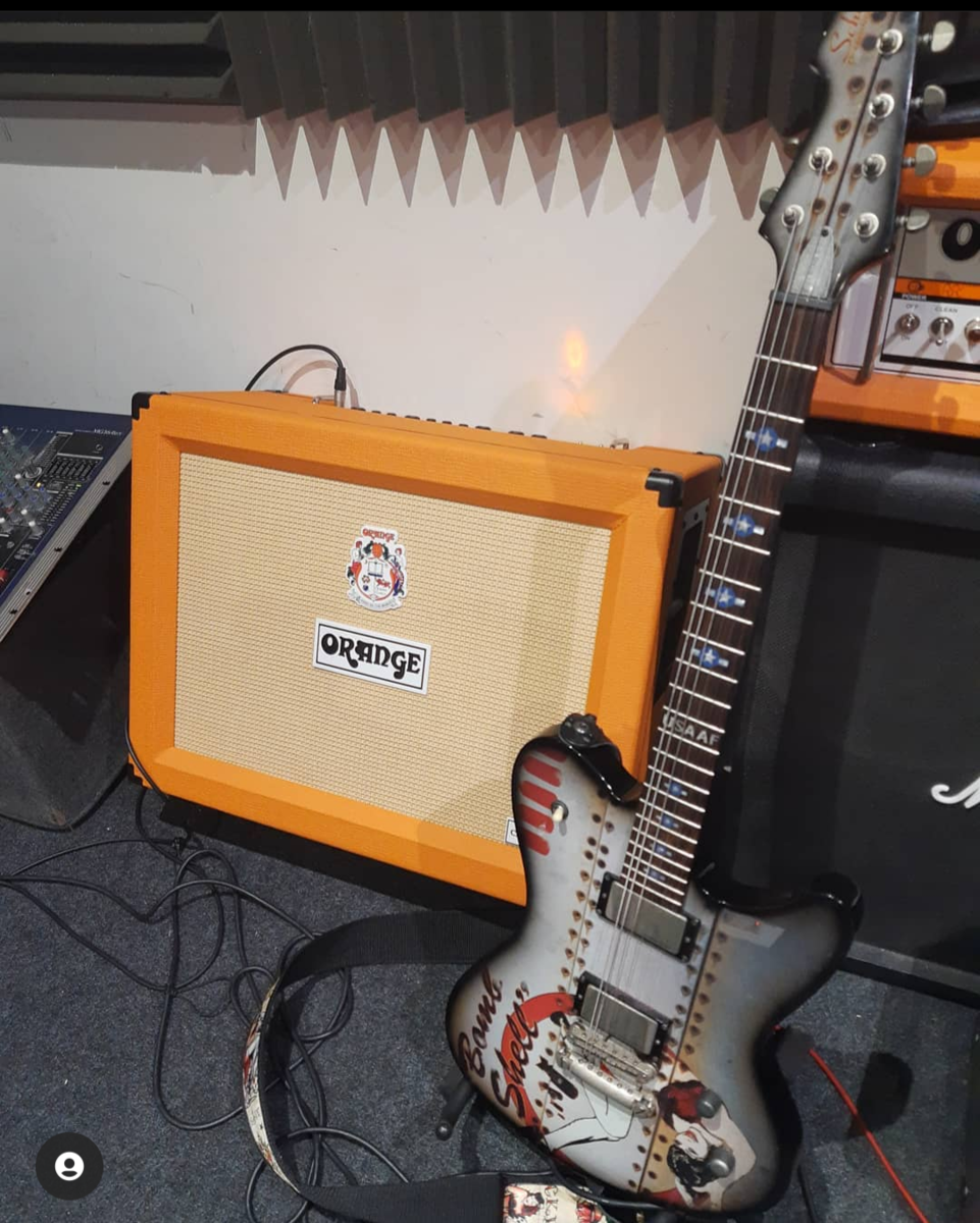 craig_st_clair's music gear photo containing Orange Amplifiers Crush Pro CR120C 120W 2x12 Guitar Combo Amp and Schecter Diamond Series Ultra B-17 Bombshell