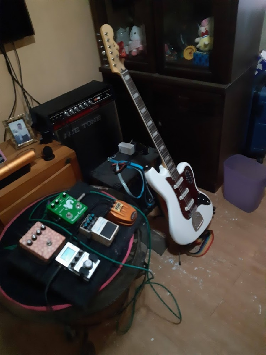Photo of Zoom MS-50G Multistomp and more gear in a pedalboard, guitar, and signal chain