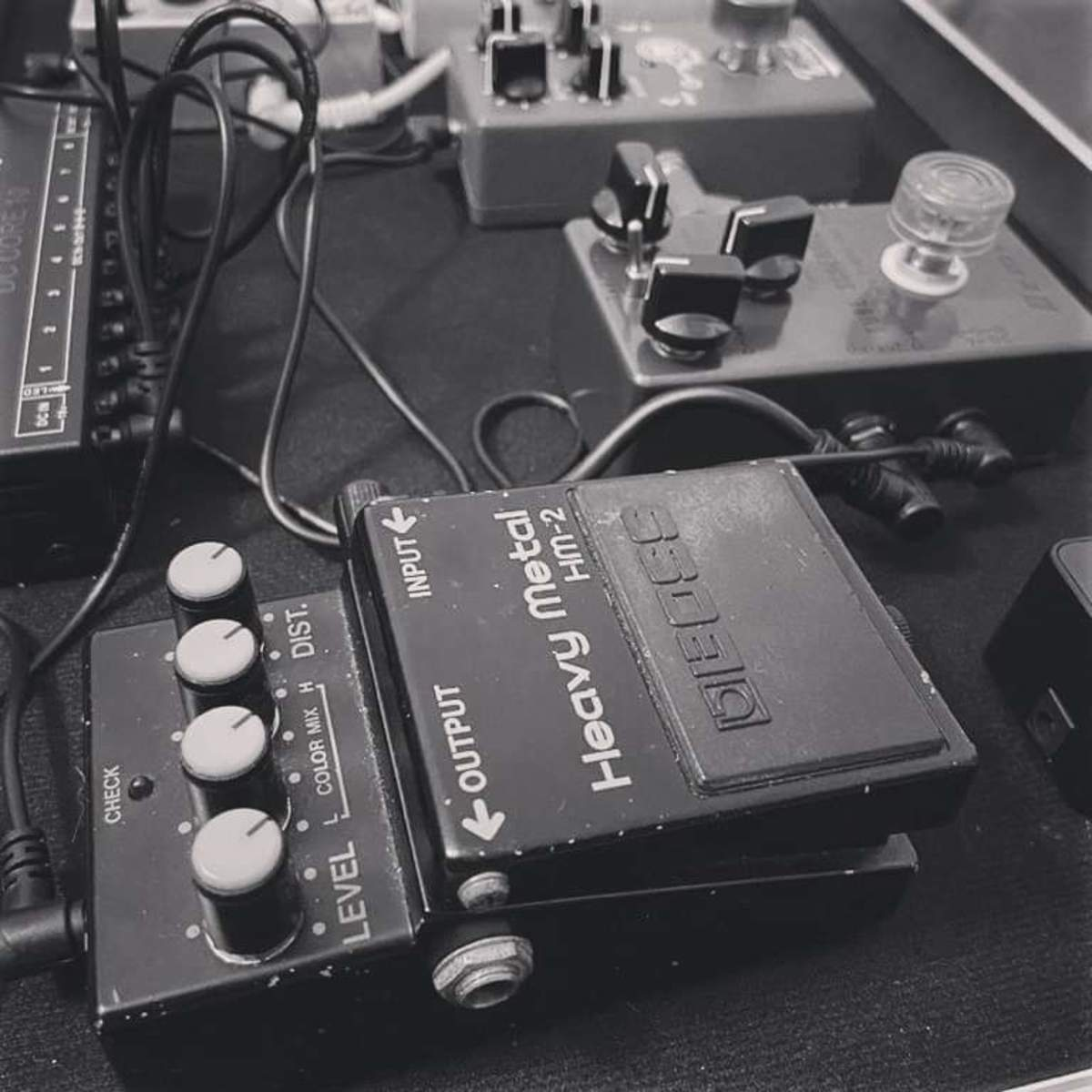 Photo of Boss HM-2 Heavy Metal and more gear in a pedalboard