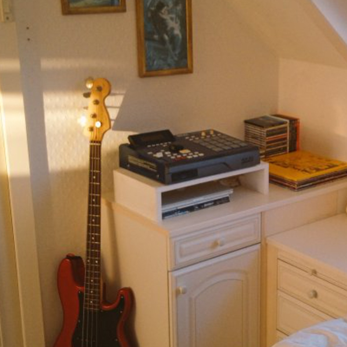 Photo of Apple MacBook Pro and more gear in a studio and Bass