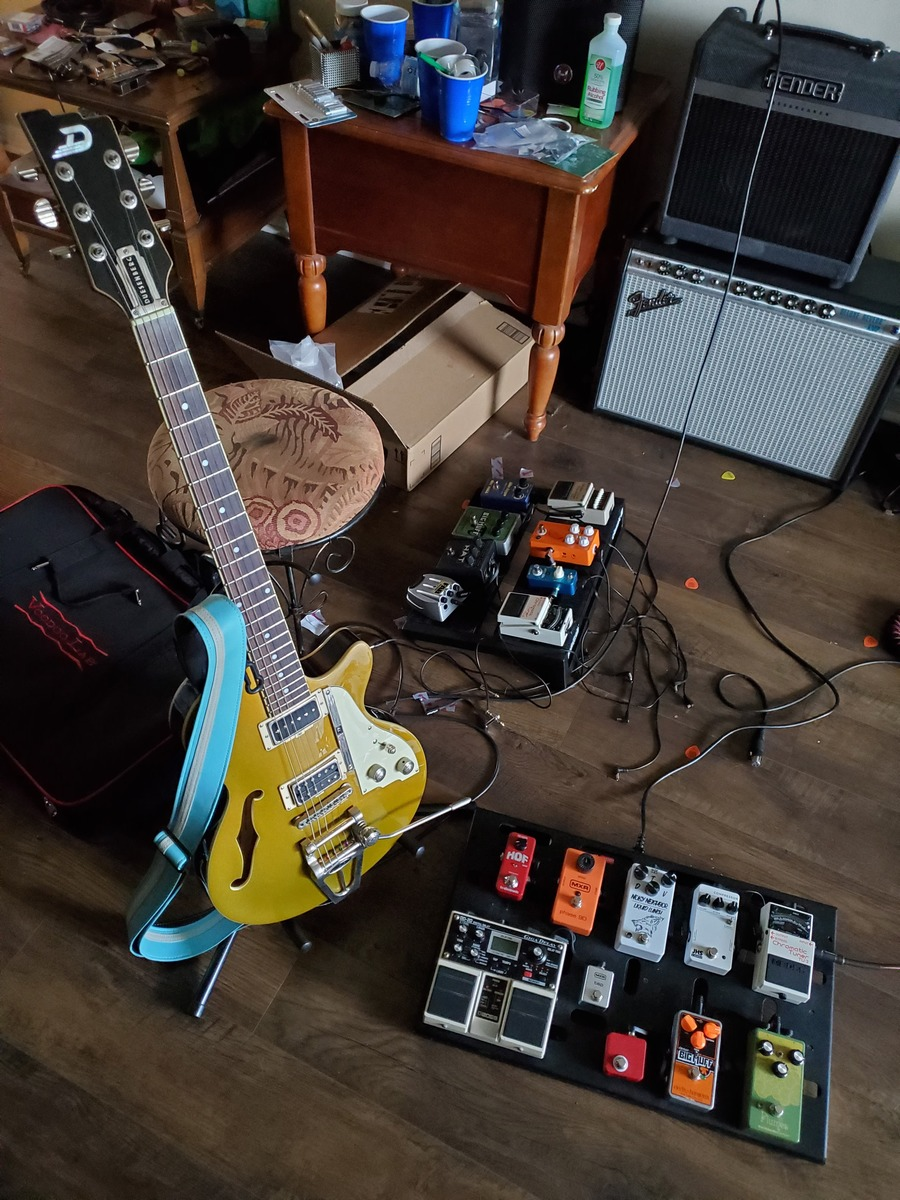 Photo of Fender '68 Custom Deluxe Reverb Guitar Amplifier and more gear in a pedalboard and guitar