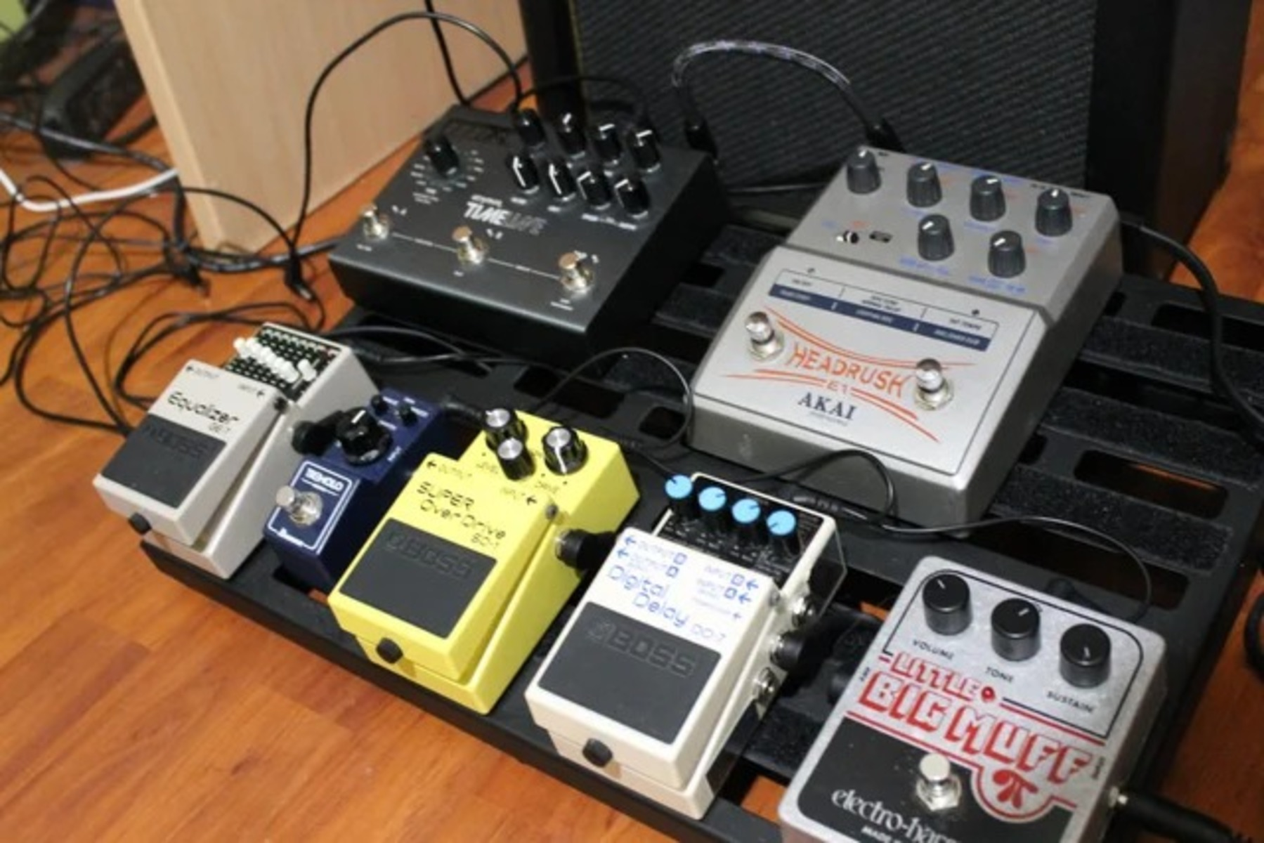 Photo of Boss SD-1 Super OverDrive and more gear in a pedalboard, guitar, and signal chain